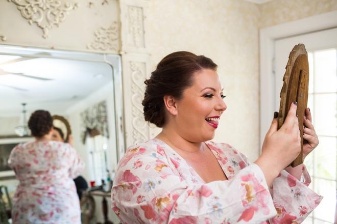 Bride admiring her hair