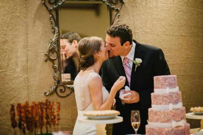 Cutting the sprinkle wedding cake