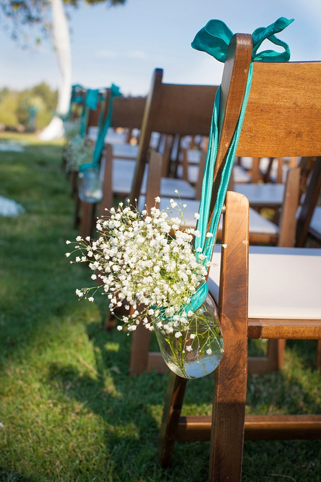 Mason jars hanging from chairs