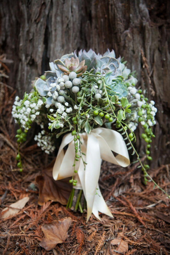 Stunning succulent wedding bouquet with long ribbons