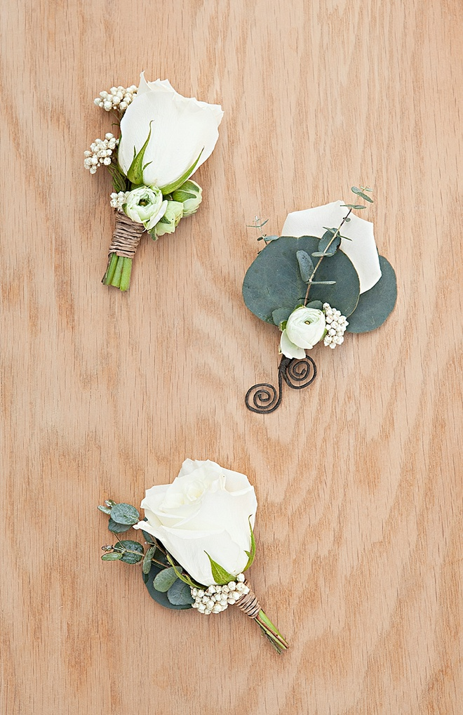 Gorgeous DIY eucalyptus and ranunculus wedding boutonnieres