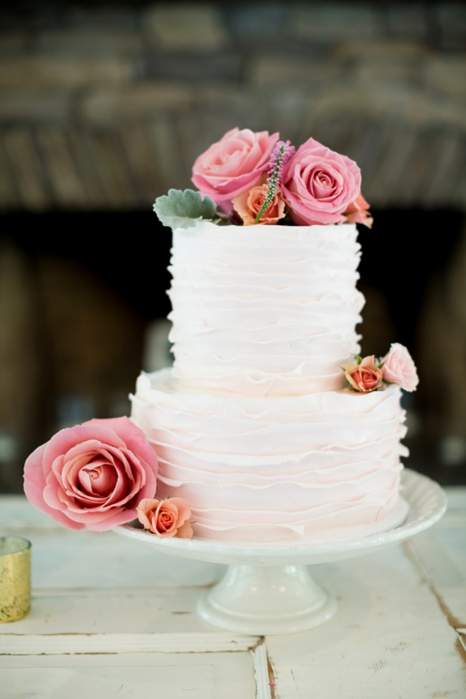 Beautiful ruffled cake embellished with flowers.