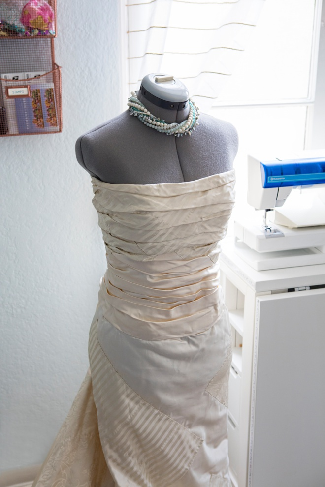 Jen's wedding dress on a dress form in her blog office.