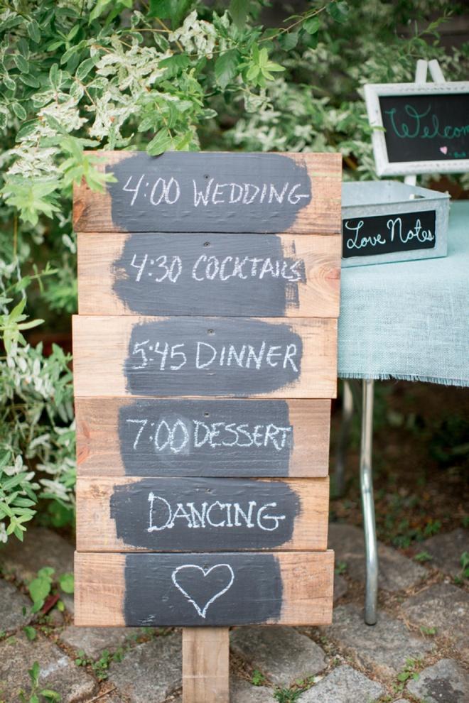 DIY wood and chalkboard wedding sign.