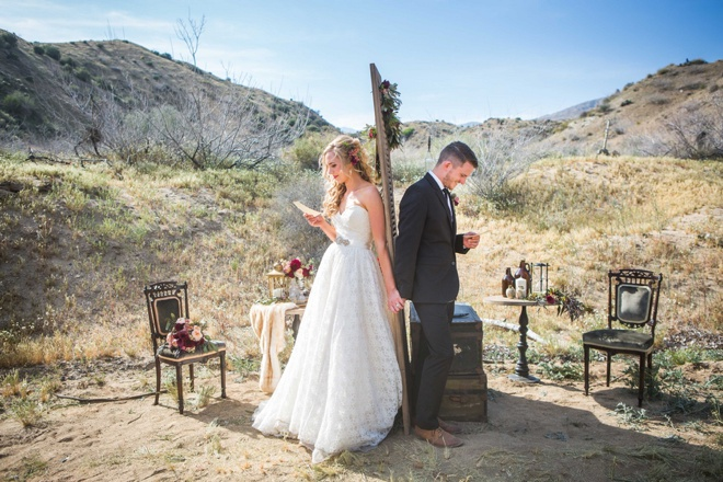 Bride and groom reading letters they wrote to each other!