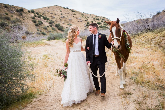 Bride and Groom portraits taken with their horse
