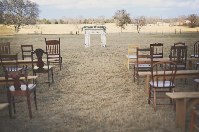 Stunning outdoor ceremony with random wooden chairs!