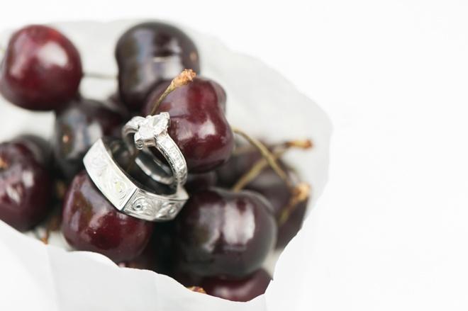 Custom wedding rings shot in cherries