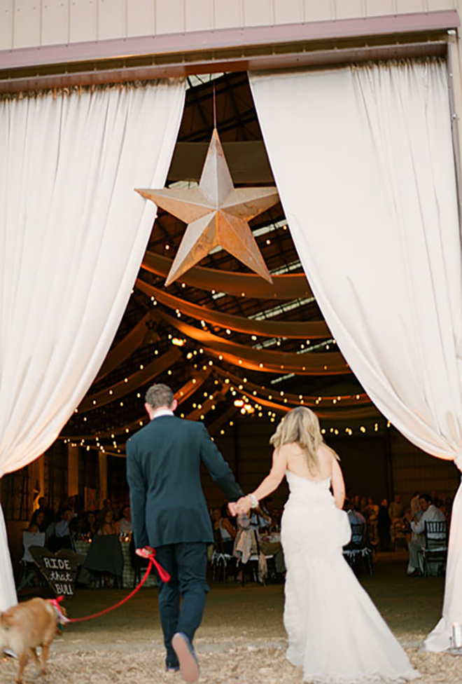 Barn drapes and a giant metal star, perfect for a Texas wedding!