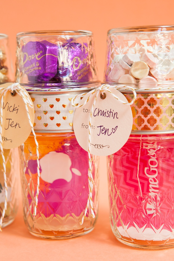 Glue two mason jar lids together to make the most darling gift card and candy holder!