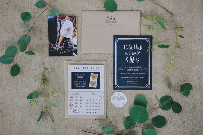 We love this neutral and navy wedding invite set framed in dreamy euclyptus!