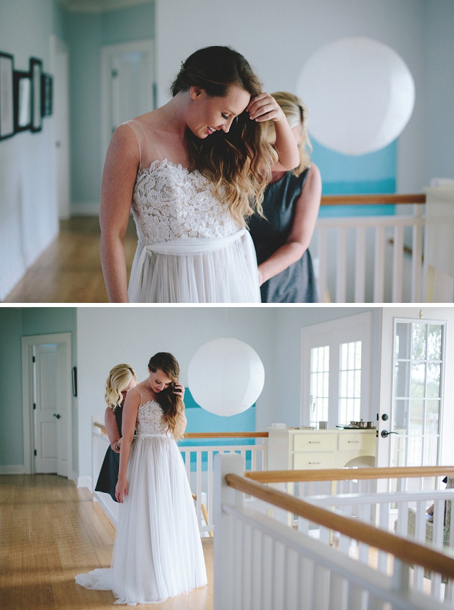 Darling bride getting into her wedding dress with the mother of the bride!