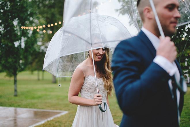 We're loving this rainy wedding and the gorgeous umbrella shots! So gorgeous!