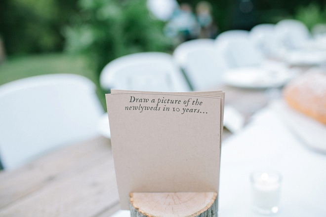 We love these fun question cards for guests at this backyard wedding!