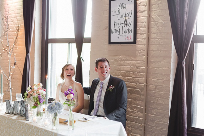 We're loving this fun shot of the Bride and Groom at their sweetheart table!