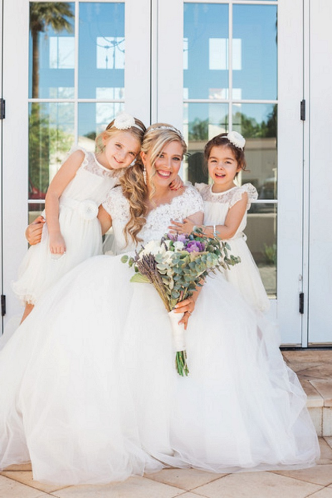 How darling is this photo of the Bride and her flower girls?! So sweet!