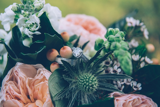 We're swooning over this gorgeous bouquet and ring shot!