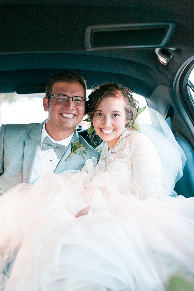 Such a sweet shot of the Bride and Groom leaving their wedding! Love it!