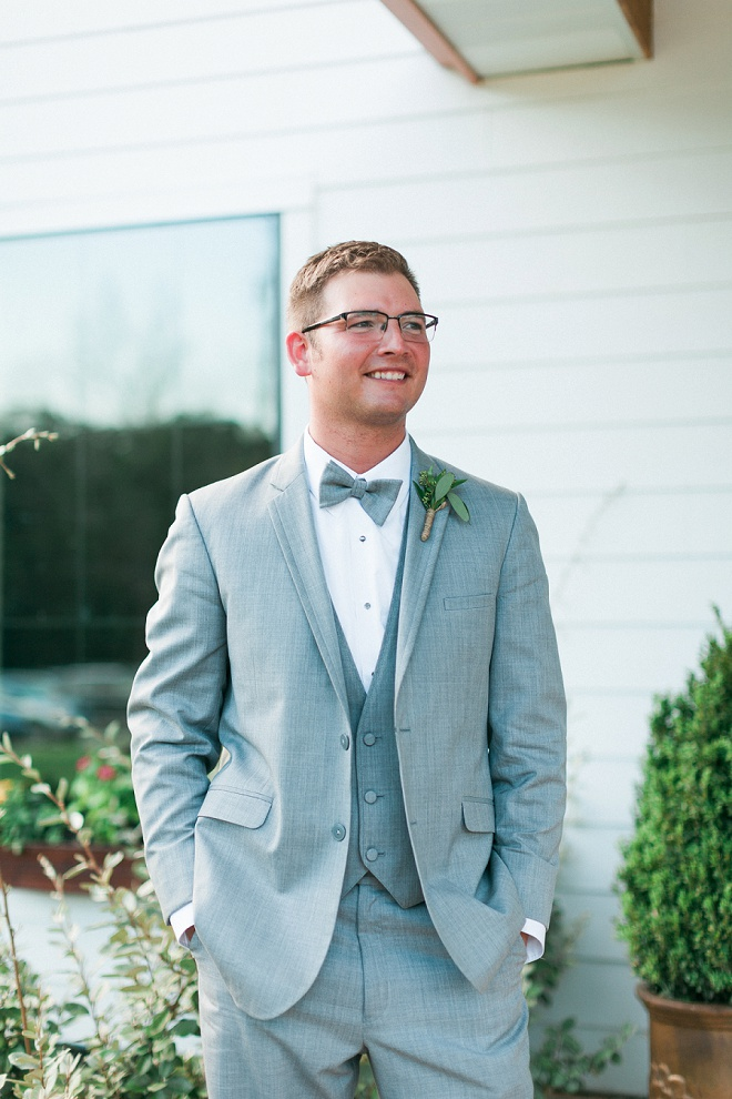Handsome Groom with his boho chic green boutonniere!