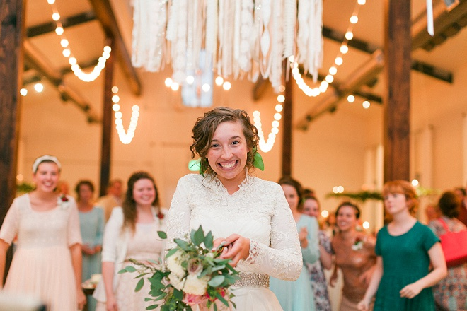 We love this shot of the Bride before she throws her gorgeous bouquet!