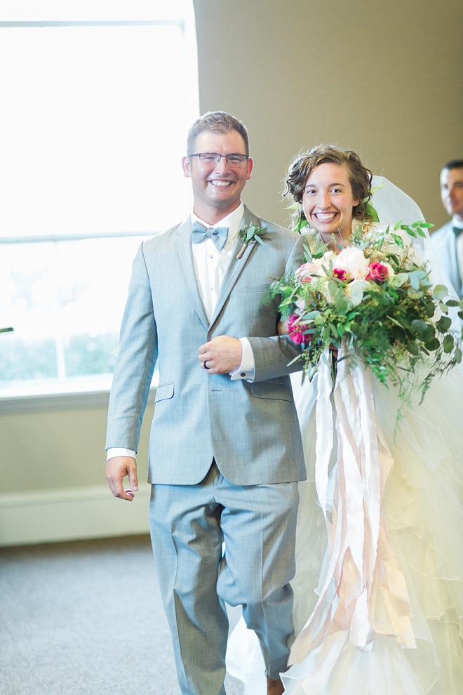 The happy couple leaving their gorgeous boho ceremony!