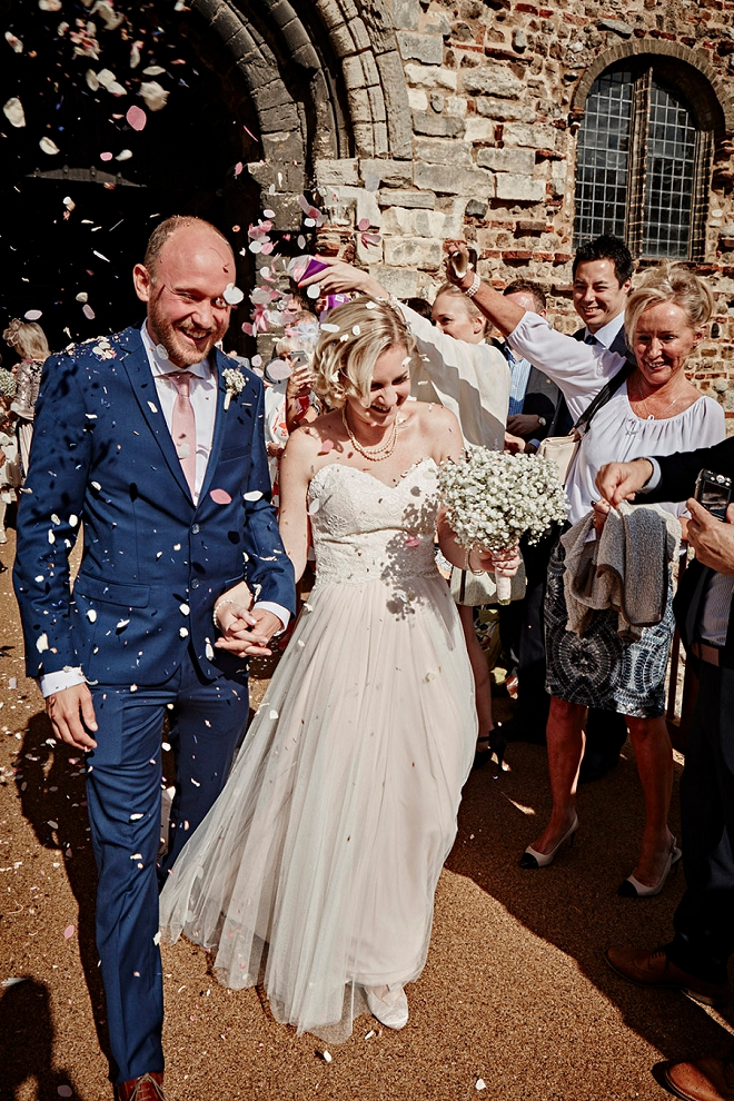 Loving this fun photo of the Bride and Groom after their ceremony with a confetti exit!