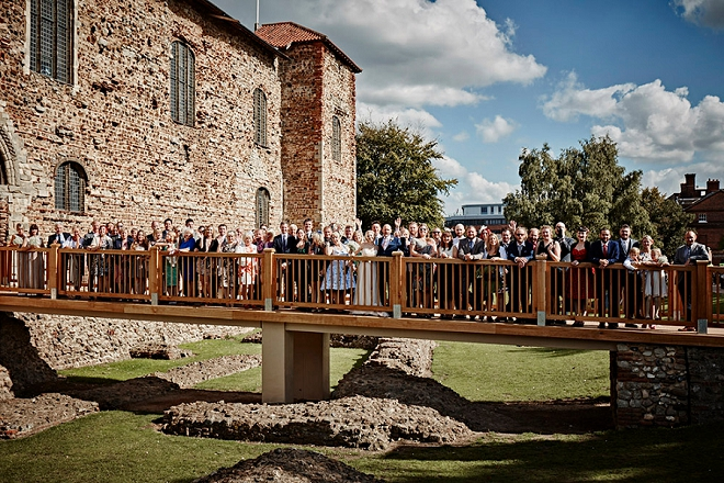 What a fun photo of the entire wedding at this UK castle wedding ceremony!