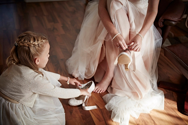 How darling is this Flower Girl helping the Bride get ready for the big day? So sweet!