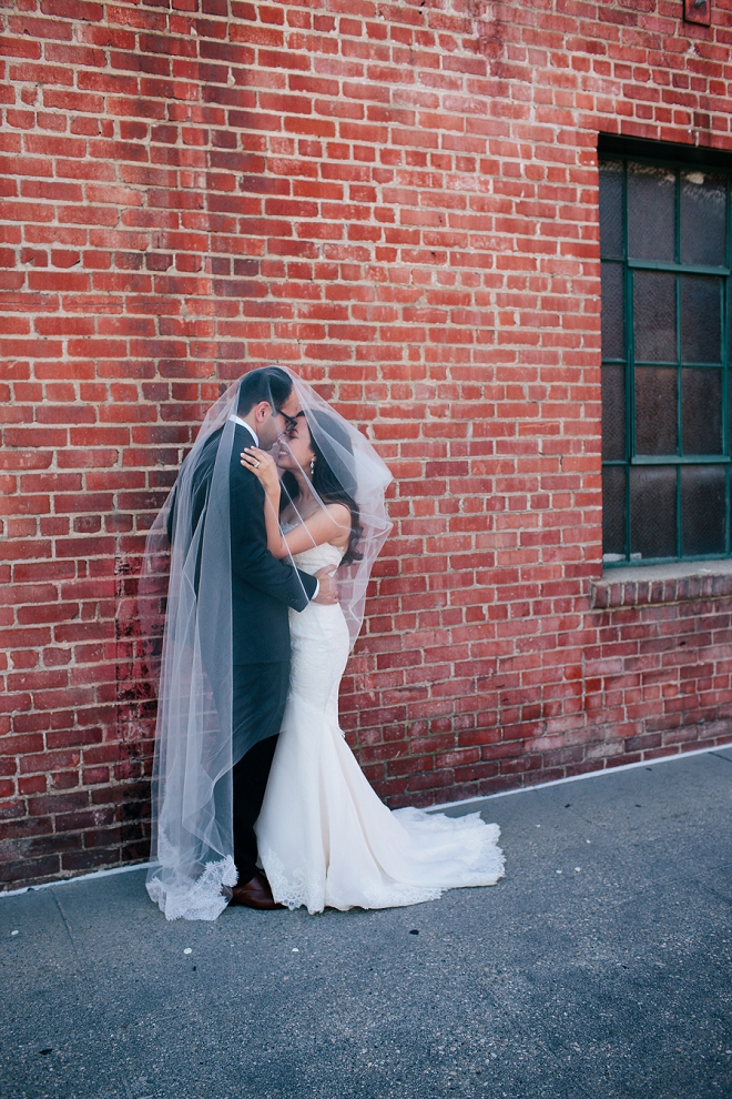 We're loving this gorgeous couple and this Bride's veil shots! So fun and romantic!