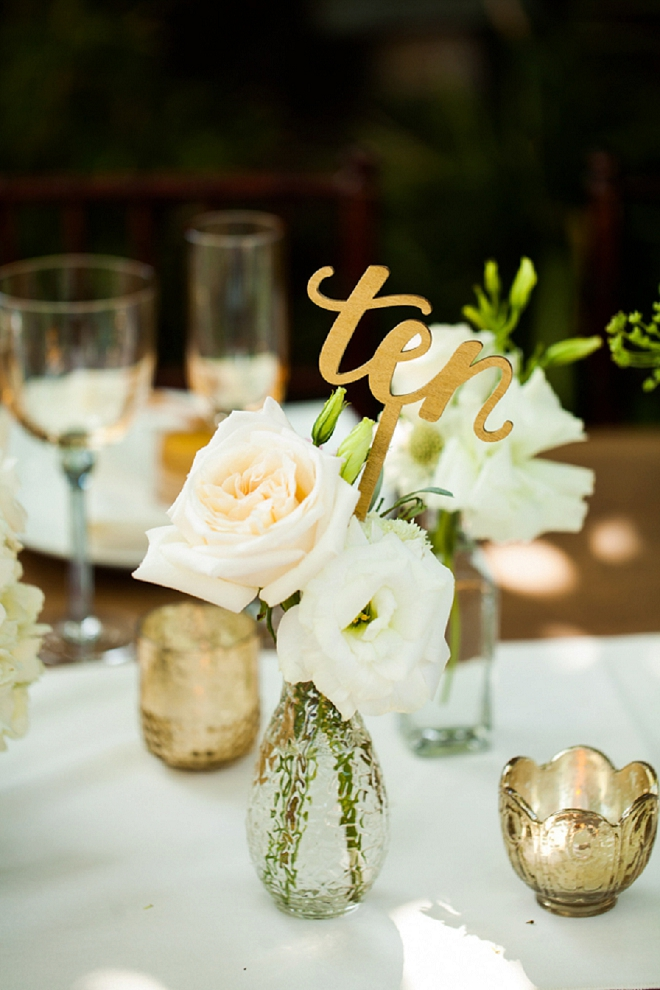 We're swooning over these gorgeous centerpiece and table numbers!