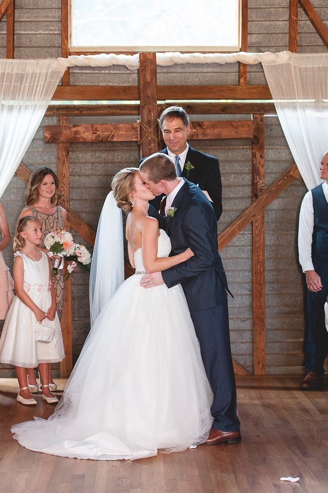 Loving this darling first kiss as Mr. and Mrs!