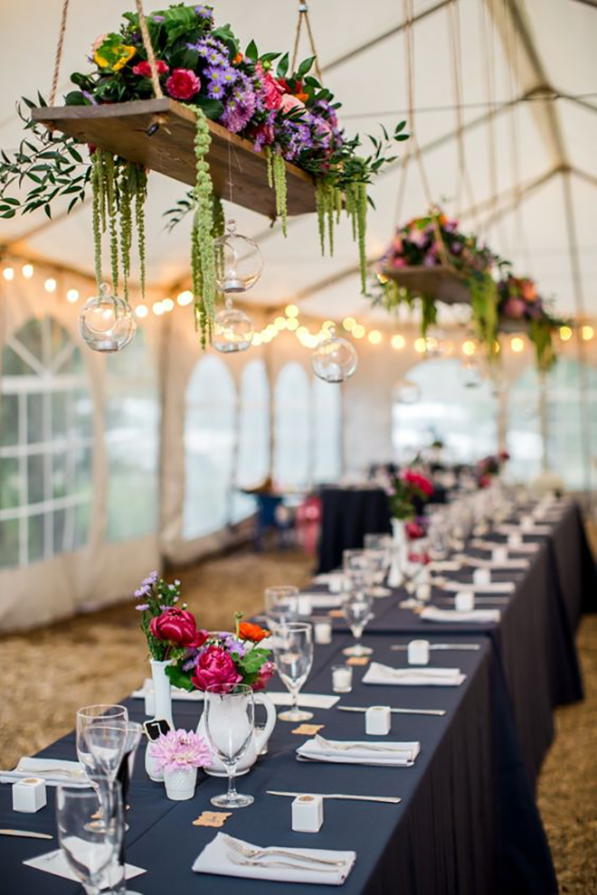 Hanging platforms with florals is a great way to dress up your wedding tent