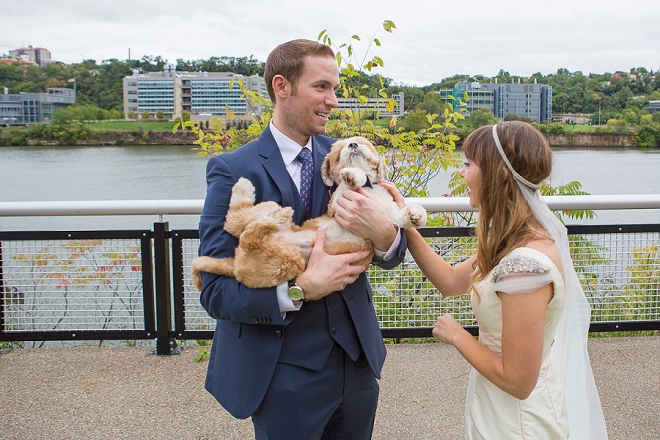 We're loving this hilarious shot of the Bride and Groom with their pup! So cute!