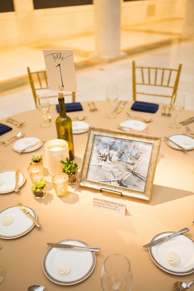 We're loving the wine bottle table numbers and navy details at this gorgeous art museum wedding!