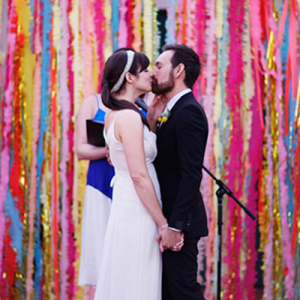 Loving this gorgeous handmade paper streamer ceremony backdrop!