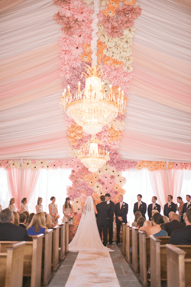 We're SWOONING over this amazing floor to ceiling floral ceremony backdrop!