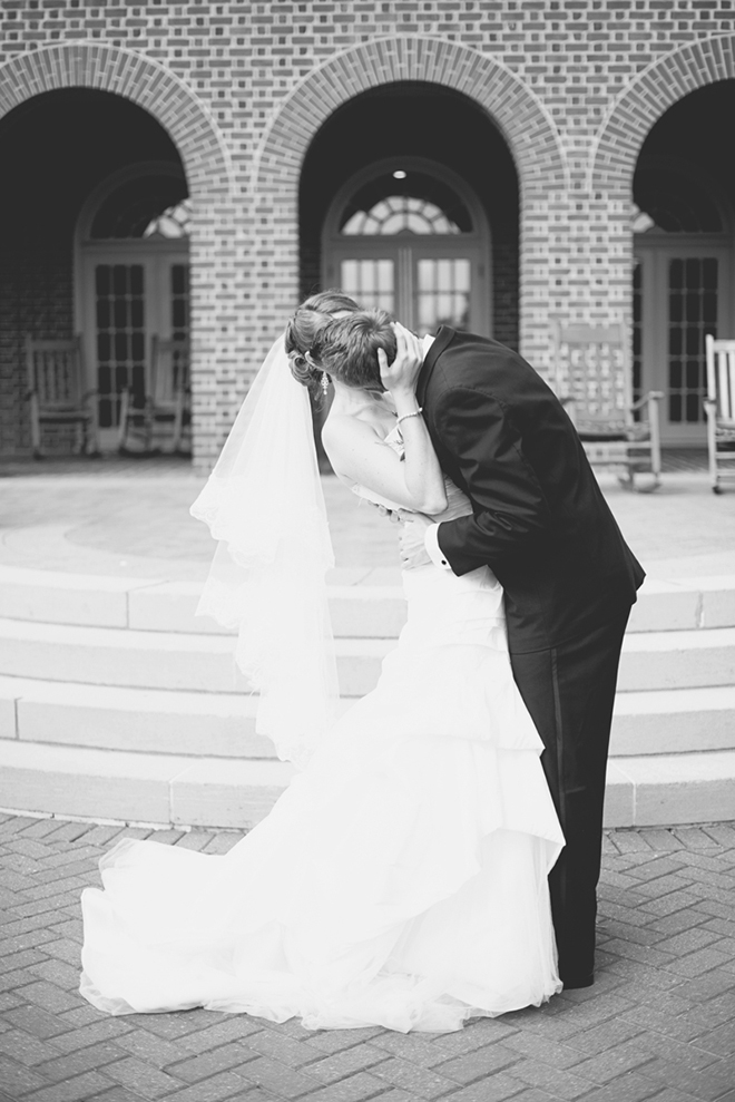 Beautiful shot of a groom kissing his bride!