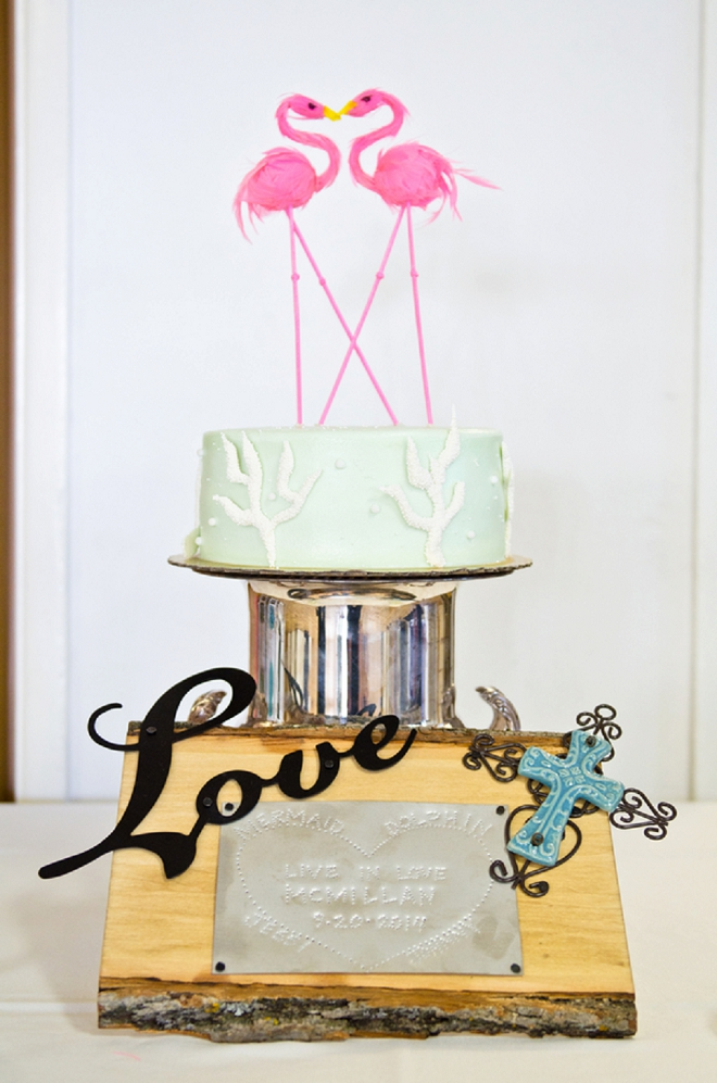 We LOVE the handmade flamingo cake topper!