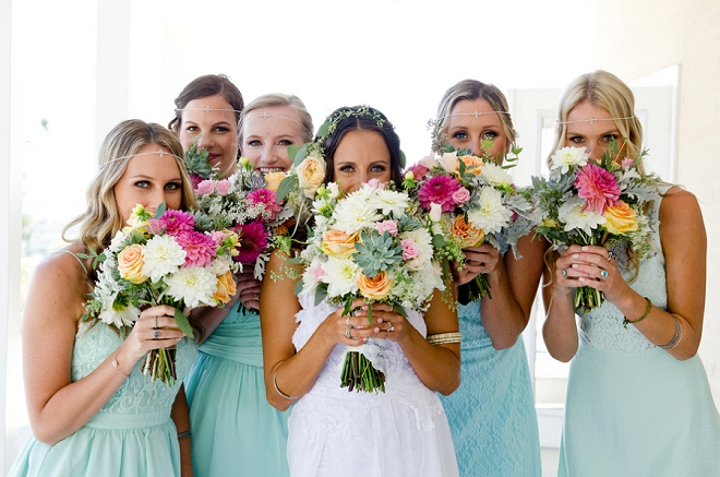 How darling is this snap of the Bride and her Bridesmaids with their super colorful bouquets?! LOVE!