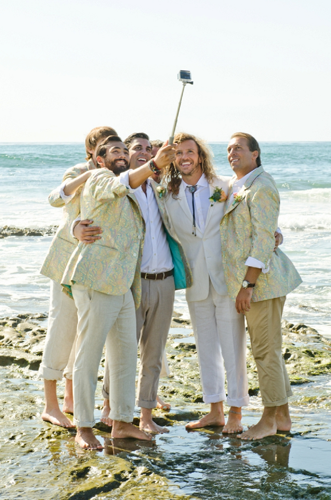 Great shot of the Groom and Groomsmen at the beach before the ceremony!