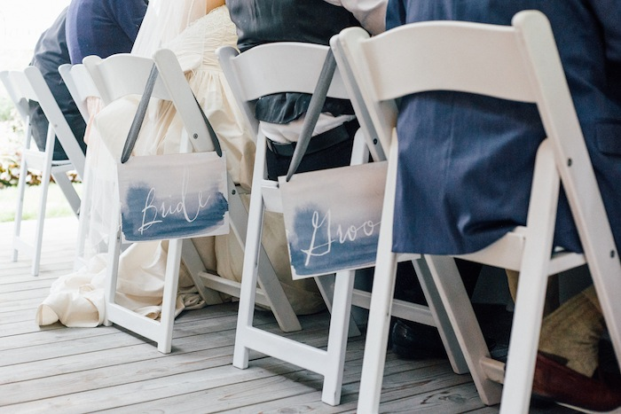 Love these free printable bride and groom chair signs.  Cheap and easy!
