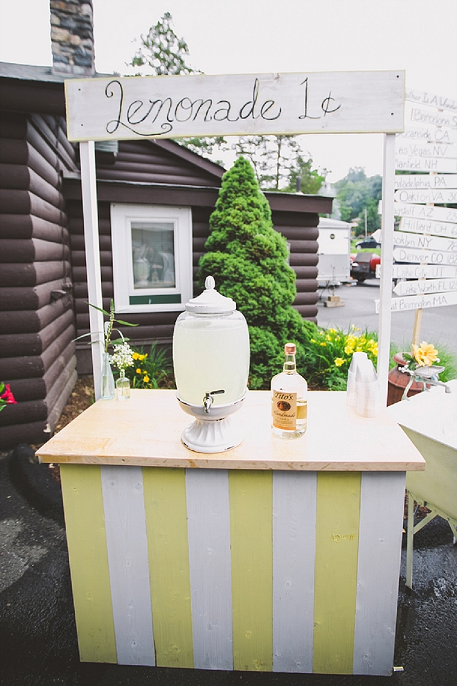 We're obsessed with this stunning DIY'd lemonade stand at this couples cocktail reception!
