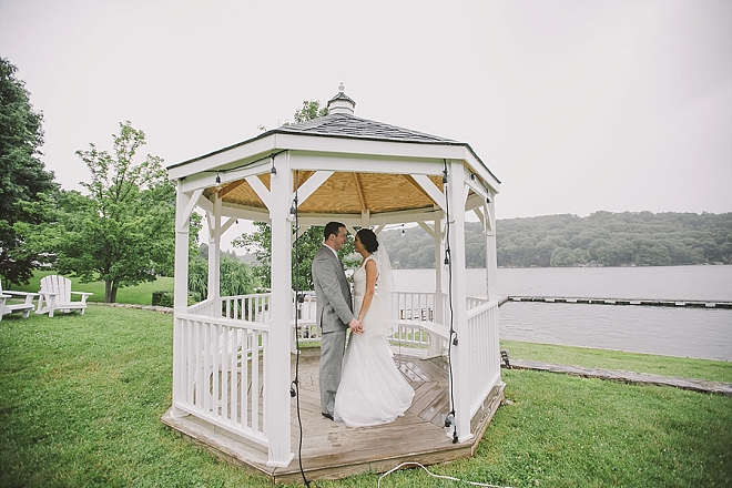 We love this super romantic first look in the lakeside gazebo!