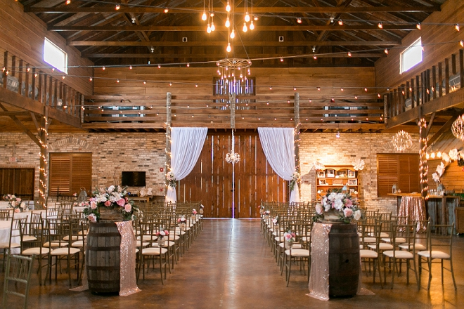 We're swooning over this rustic and romantic barn ceremony location!