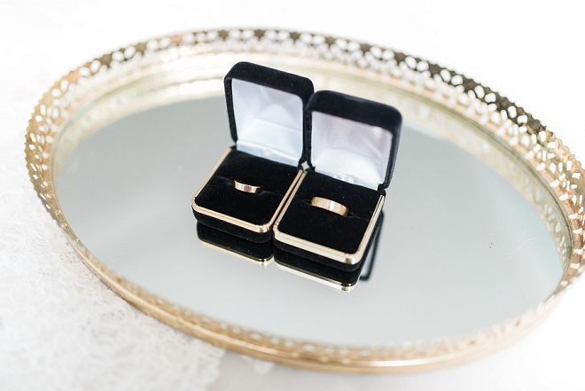 We love this couple's gold modern wedding bands!