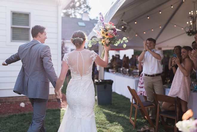 Entering their backyard reception as Mr. and Mrs!