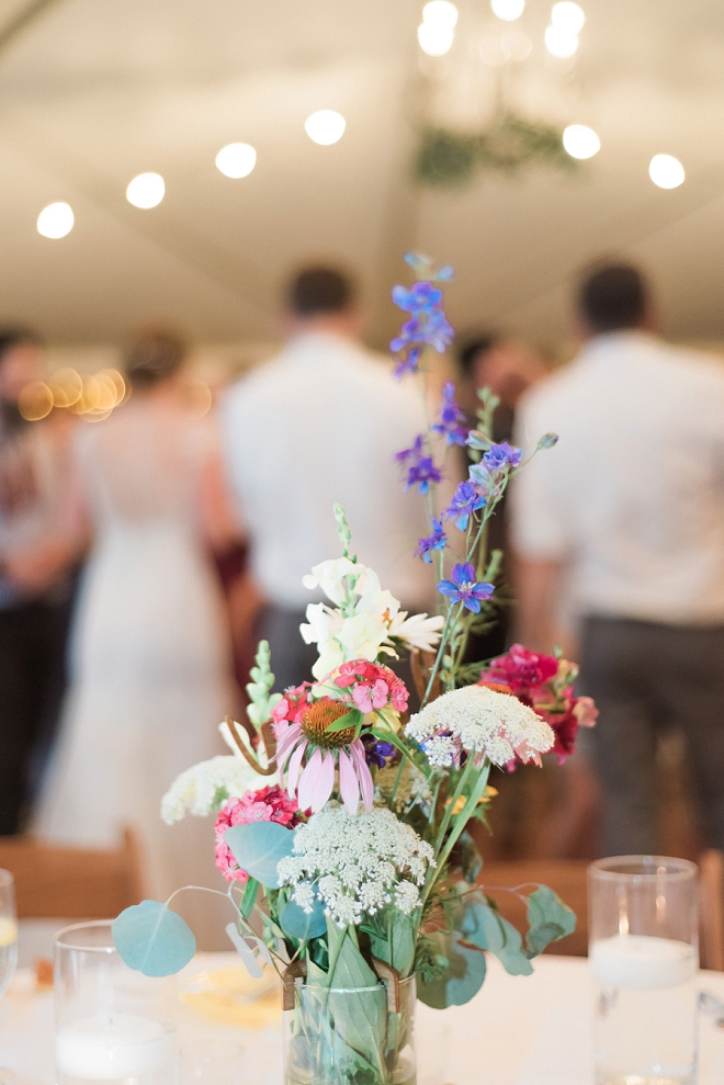 We're loving these wildflower handmade centerpieces at this reception!