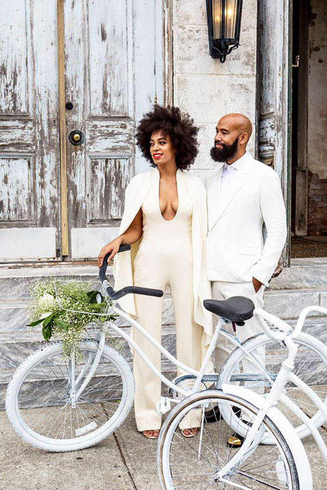 Channel Solange with a white cape a wedding cover up.