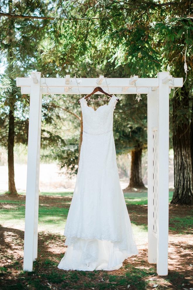 We're loving this Bride's wedding dress!!