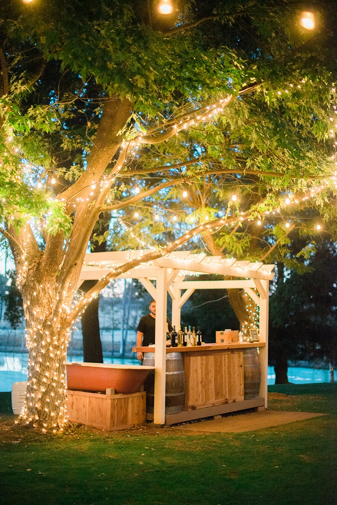 How gorgeous is this couple's bar?! Twinkle lit and beautiful!